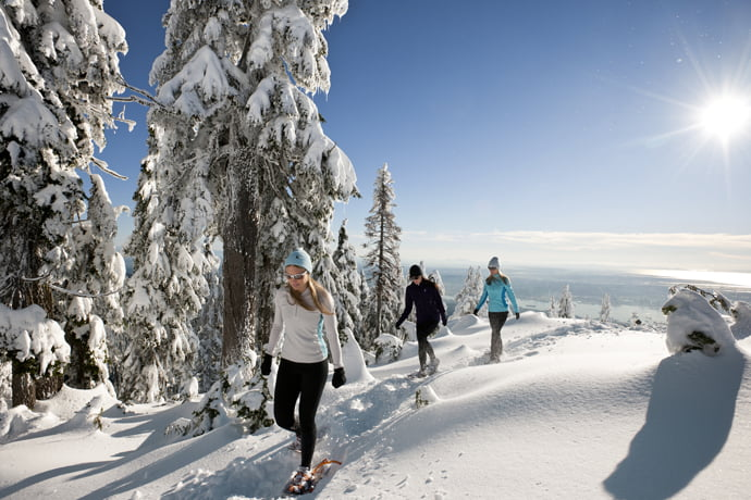 Snowshowers On Grouse Mountain In BC
