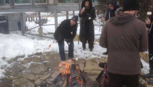 Visitors roast icewine-infused marshmellows at Flat Rock Cellars.