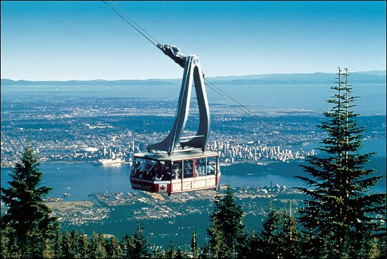 Enjoy views of Vancouver city while you ride the Skyride gondola to the top of Grouse Mountain for family fun and adventure. (Photo credit: Grouse Mountain)