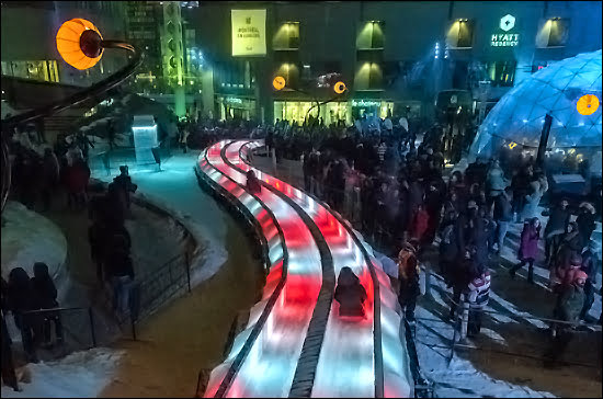 Taking a ride down the free Urban Slide at the Montreal en Lumiere outdoor site in the Place des Festivals. (Julia Pelish/Vacay.ca)