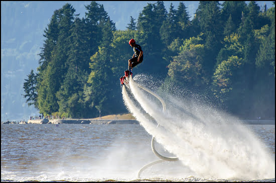 The BC Flyboard team entertained the throngs packing the beaches Saturday as they propelled high into the air and doing what look liked 'wheelies' on jets of water spray. (Julia Pelish/Vacay.ca)