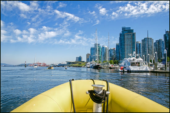 The tour begins in Coal Harbour and starts out to explore Vancouver busy port on Sea Vancouver's sightseeing tour. (Julia Pelish/Vacay.ca)