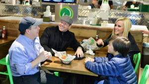 Paul Wahlberg, left, is the chef in the family while Donnie Wahlberg and his wife, Jenny McCarthy, are delighted diners at the recently opened Wahlburgers restaurant in Toronto. Elijah Wahlberg, Donnie's son, joins in the fun. (George Pimentel photo)
