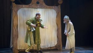 Jeff Meadows as Christmas Present and Michael Therriault as Ebenezer Scrooge in the Shaw Festival's production of A Christmas Carol. Photo by David Cooper.
