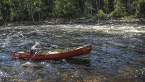 Instructor Stefani Van Wijk paddles into the rapids of the Madawaska River.