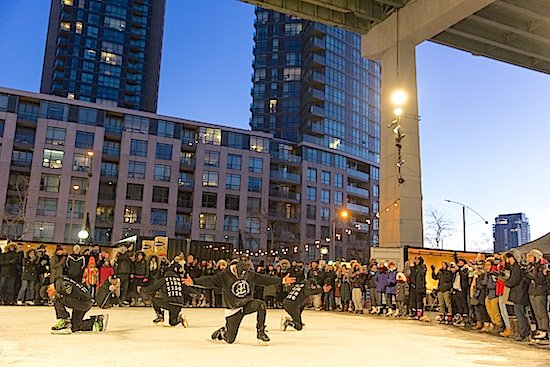 The Toronto Ice Skate Group performs on opening day at The Bentway Skate Trail - Andrew Williamson