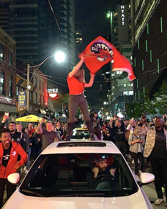 raptors-fan-on-car-roof