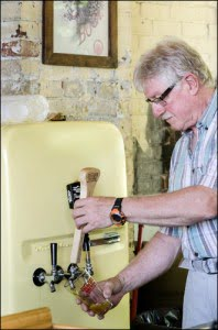 Grand-River-Brewing-Bob-Hanenberg-pouring-beer