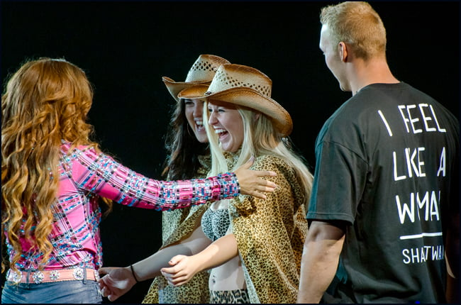 Shania Twain greets welcomes very lucky fans picked from the audience to join her on stage during 2014 Calgary Stampede. (Julia Pelish/Vacay.ca)