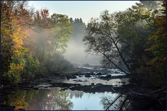 Early morning mist burns off the stream on the country resort property of Auberge Le Baluchon in Saint-Paulin, Quebec. (Julia Pelish/Vacay.ca)
