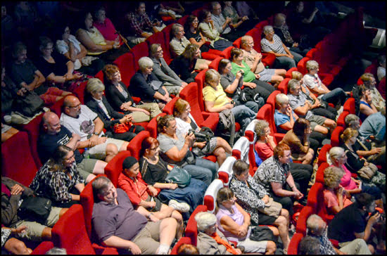 Tiff fans are grateful to be relaxing inside the theatre after waiting in long lines for their chance to see the newest films. (Julia Pelish/Vacay.ca)