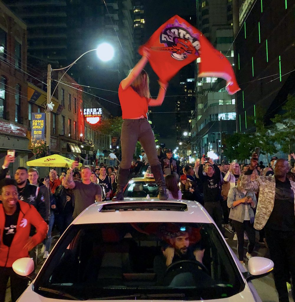 raptors-fan-on-car-roof-toronto
