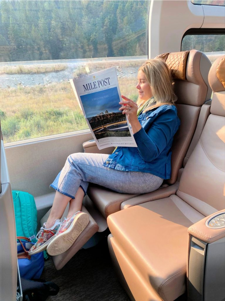 lady reading rocky mountaineer paper
