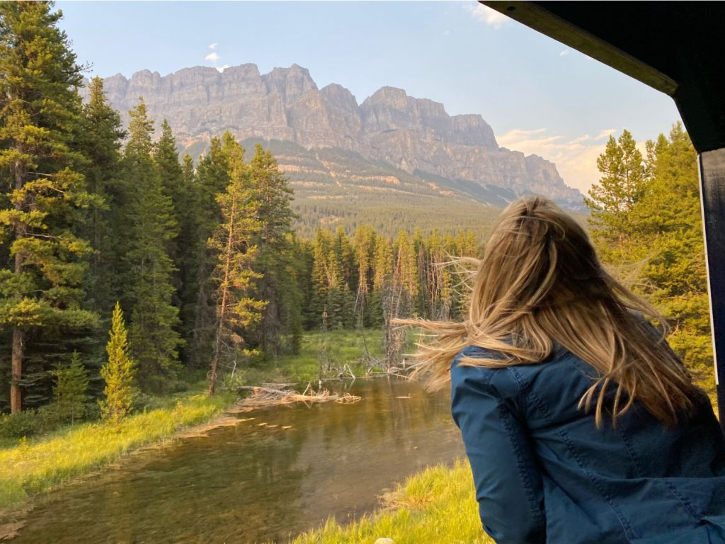 lady looking at mountain on train